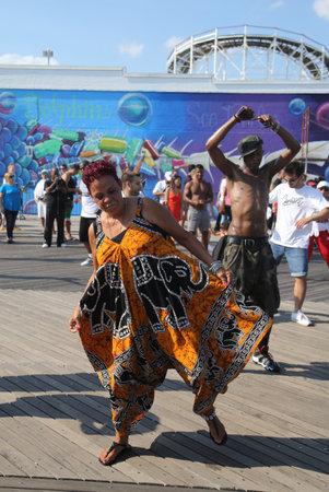 BROOKLYN, NEW YORK - AUGUST 19, 2017: People dance on the Coney Island Boardwalk in Brooklyn Editorial