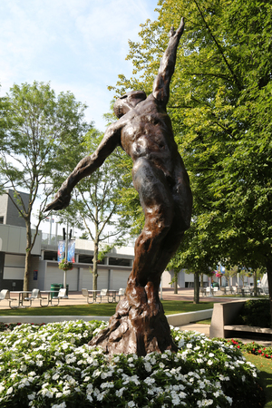 NEW YORK - AUGUST 21, 2017: Arthur Ashe Statue in front of the Arthur Ashe Stadium  at the Billie Jean King National Tennis Center in Flushing, NY