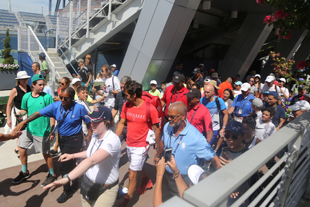 NEW YORK - AUGUST 23, 2017: Nineteen times Grand Slam Champion Roger Federer of Switzerland walking toward Grandstand stadium surrounded by tennis fans during US Open 2017