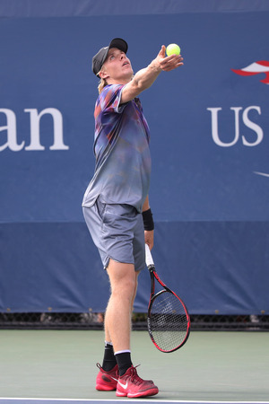 NEW YORK - AUGUST 28, 2017: Professional tennis player Denis Shapovalov of Canada in action during his US Open 2017 first round match at Billie Jean King National Tennis Center in New York Editorial