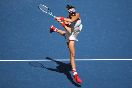 NEW YORK - AUGUST 28, 2017: Grand Slam Champion Garbina Muguruza of Spain in action during her US Open 2017 first round match at Billie Jean King National Tennis Center in New York Editorial