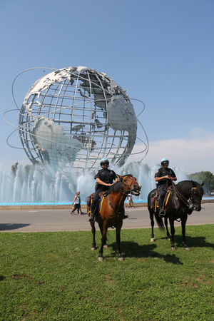 squad: NEW YORK - SEPTEMBER 5,2017: NYPD mounted unit police officer ready to protect public in Flushing Meadows Park in New York