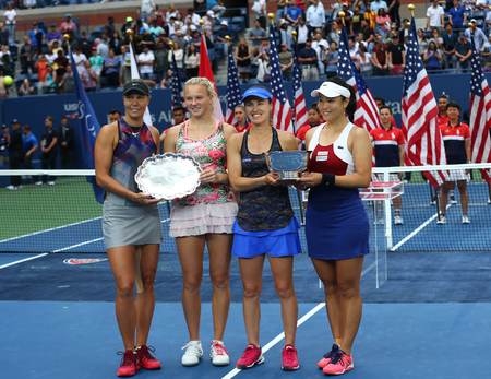 NEW YORK - SEPTEMBER 10, 2017: US Open 2017 womens doubles finalists Lucie Hradecka (L), Katerina Siniakova, and champions Martina Hingis and Chan Yung-Jan during trophy presentation in New York
