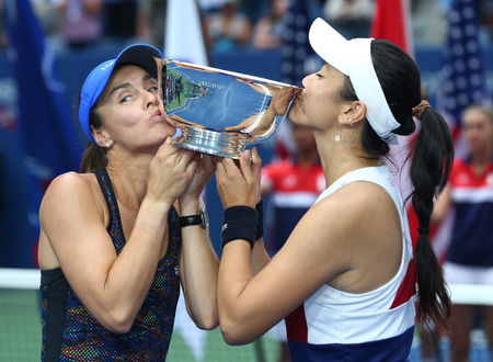 NEW YORK - SEPTEMBER 10, 2017: US Open 2017 womens doubles champions Martina Hingis of Switzerland (L) and Chan Yung-Jan of Taiwan during trophy presentation in New York Editorial