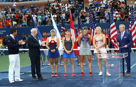 NEW YORK - SEPTEMBER 10, 2017: US Open 2017 womens doubles champions Chan Yung-Jan (L), Martina Hingis and finalists Lucie Hradecka and Katerina Siniakova during trophy presentation in New York