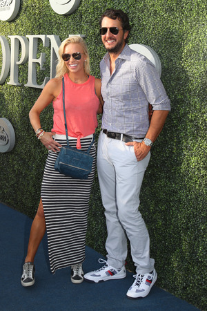 NEW YORK - AUGUST 28, 2017: American country singer and songwriter Luke Bryan and Caroline Boyer on the blue carpet before US Open 2017 opening night ceremony at Tennis Center in New York