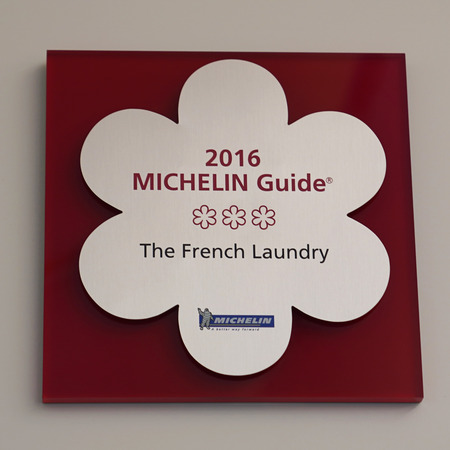 YOUNTVILLE, CALIFORNIA - SEPTEMBER 21, 2017: Three Michelin Stars sign in The French Laundry restaurant in Yountville, Napa Valley. The chef and owner of the French Laundry is Thomas Keller