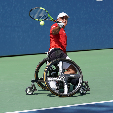 NEW YORK - SEPTEMBER 9, 2017:  US Open 2017 Wheelchair Mens Singles champion Stephane Houdet of France in action during Wheelchair Mens Singles semifinal at Billie Jean King National Tennis Center