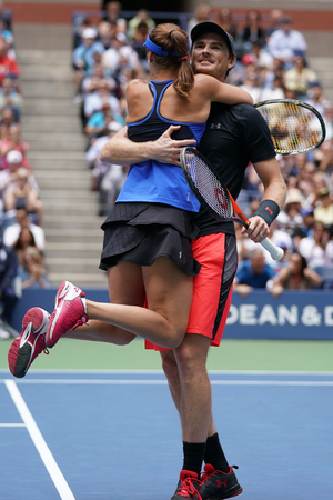 NEW YORK - SEPTEMBER 9, 2017: US Open 2017 mixed doubles champions Jamie Murray of Great Britain and Martina Hingis of Switzerland in action during final match at Billie Jean King National Tennis Center in New York