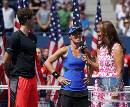 NEW YORK - SEPTEMBER 9, 2017: US Open 2017 mixed doubles champions Jamie Murray of Great Britain and Martina Hingis of Switzerland during trophy presentation at Billie Jean King National Tennis Center