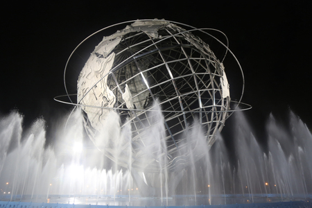 NEW YORK - SEPTEMBER 3, 2017: 1964 New York World s Fair Unisphere at night in Flushing Meadows Park. It is the worlds largest global structure, rising 140 feet and weighing 700 000 pounds Editorial