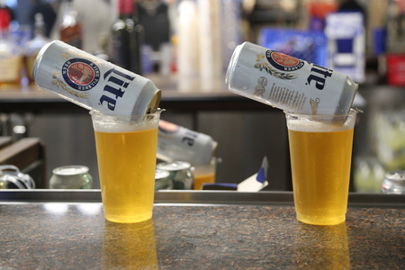 NEW YORK - SEPTEMBER 3, 2017: Miller Lite beer ready to serve in pub. Miller Lite, also known simply as Lite, is a pilsner light beer brand sold by MillerCoors of Milwaukee, Wisconsin, USA Editorial