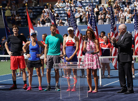 NEW YORK - SEPTEMBER 9, 2017: US Open 2017 mixed doubles champions Jamie Murray of GBR (L), Martina Hingis SHE and finalists Michael Venus NZL and Hao-Ching Chan TWN  during trophy presentation Editorial