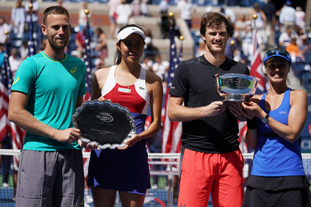 NEW YORK - SEPTEMBER 9, 2017: US Open 2017 mixed doubles finalists Michael Venus NZL (L), Hao-Ching Chan TWN  and champions Jamie Murray of GBR and Martina Hingis SHE during trophy presentation