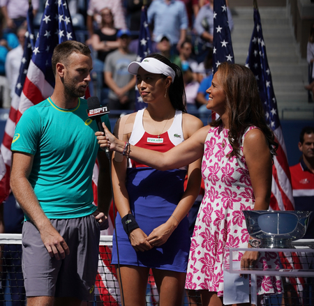 NEW YORK - SEPTEMBER 9, 2017: US Open 2017 mixed doubles finalists Michael Venus of New Zealand and Hao-Ching Chan of Taiwan during trophy presentation at Billie Jean King National Tennis Center