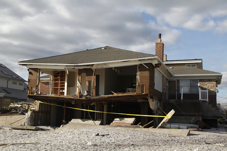 FAR ROCKAWAY, NEW YORK - NOVEMBER 4, 2012: Destroyed beach house in the aftermath of Hurricane Sandy in Far Rockaway, New York. Image taken 5 days after Superstorm Sandy hit New York