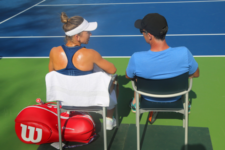 cahill: NEW YORK - AUGUST 23, 2017: Professional tennis player Simona Halep of Romania with her coach Darren Cahill in practice for US Open 2017 at Billie Jean King National Tennis Center Editorial