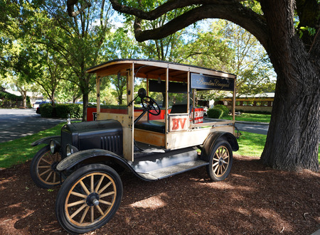 RUTHERFORD, CALIFORNIA - SEPTEMBER 21, 2017: Antique car in front of the Beaulieu Vineyard in Napa Valley
