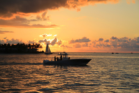 KEY WEST, FLORIDA - MAY 30, 2016: Tourists enjoy boat ride during sunset in Key West