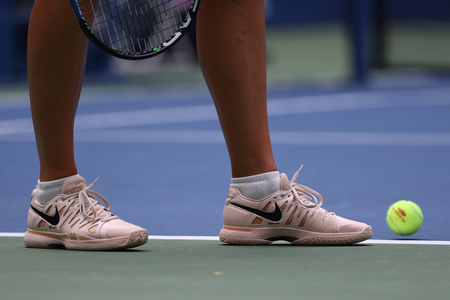 NEW YORK - SEPTEMBER 3, 2017: Five times Grand Slam Champion Maria Sharapova of Russian Federation wears custom Nike tennis shoes during 2017 US Open round 3 match in New York