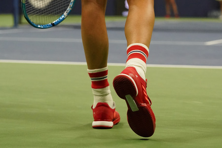 NEW YORK - SEPTEMBER 3, 2017: Grand Slam Champion Garbina Muguruza of Spain wears custom Adidas tennis shoes by Stella McCartney during match at US Open 2017 at Billie Jean King National Tennis Center