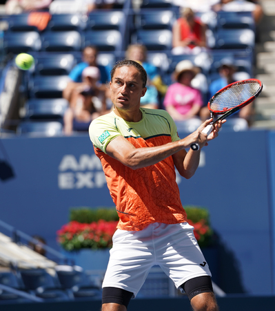 NEW YORK - SEPTEMBER 4, 2017: Professional tennis player Alexandr Dolgopolov of Ukraine in action during his US Open 2017 round 4 match at Billie Jean King National Tennis Center