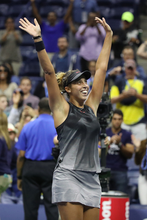 grand hard: NEW YORK - SEPTEMBER 4, 2017: Professional tennis player Madison Keys of United States celebrates victory after her US Open 2017 round 4 match at Billie Jean King National Tennis Center Editorial