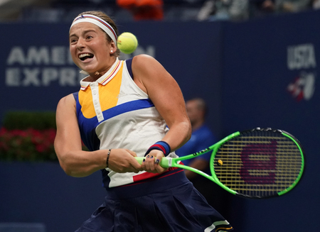 NEW YORK - AUGUST 29, 2017: Grand Slam champion Jelena Ostapenko of Latvia in action during her US Open 2017 first round match at Billie Jean King National Tennis Center