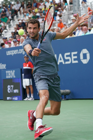 grand hard: NEW YORK - AUGUST 31, 2017: Professional tennis player Grigor Dimitrov of Bulgaria in action during his US Open 2017 second round match at Billie Jean King National Tennis Center Editorial