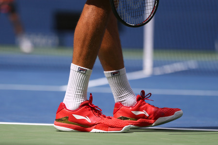 NEW YORK - AUGUST 28, 2017: Professional tennis player Marin Cilic of Croatia wears custom Li Ning tennis shoes during his first round match at 2017 US Open at National Tennis Center Editorial