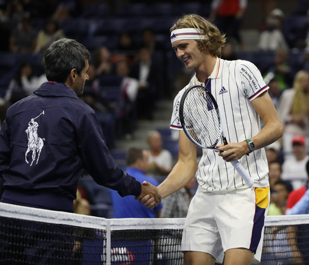 l first: NEW YORK - AUGUST 28, 2017: Tennis umpire Carlos Ramos of Portugal (L) and professional tennis player Alexander Zverev of Germany before 2017 US Open first round match at Arthur Ashe Stadium
