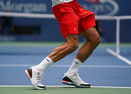 NEW YORK - AUGUST 31, 2017: Grand Slam champion Roger Federer of Switzerland wears custom Nike shoes during his US Open 2017 second round match at Billie Jean King National Tennis Center