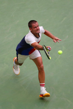 NEW YORK - AUGUST 31, 2017: Professional tennis player Mikhail Youzhny of Russia in action during his US Open 2017 round 2 match at Billie Jean King National Tennis Center
