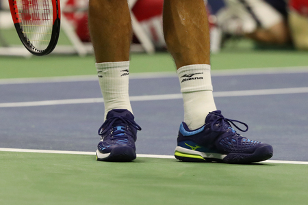 grand hard: NEW YORK - SEPTEMBER 4, 2017: Professional tennis player Philipp Kohlschreiber of Germany wears Mizuno tennis shoes during his US Open 2017 round 4 match at Billie Jean King National Tennis Center