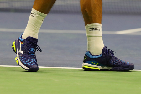 NEW YORK - SEPTEMBER 4, 2017: Professional tennis player Philipp Kohlschreiber of Germany wears Mizuno tennis shoes during his US Open 2017 round 4 match at Billie Jean King National Tennis Center