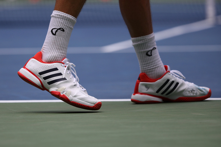 NEW YORK - AUGUST 28, 2017: Professional tennis player Tennys Sandgren of USA wears Adidas special edition Babolat 7 Novak Djokovic tennis shoes during his 2017 US Open first round match