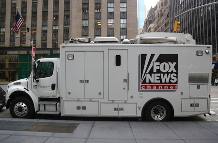 NEW YORK - NOVEMBER 16, 2017: Fox News Channel truck in the front of News Corporation headquarters building in New York City. News Corporation is an American diversified  mass media corporation