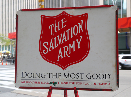 NEW YORK - NOVEMBER 16, 2017: Salvation Army red kettle for collections in midtown Manhattan. This Christian organization is known for its charity work, operating in 126 countries
