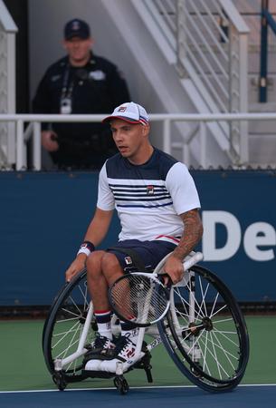 NEW YORK - SEPTEMBER 7, 2017: Wheelchair tennis player Andrew Lapthorne of Great Britain celebrates victory after his Wheelchair Quad Singles semifinal match at US Open 2017 at National Tennis Center Editorial
