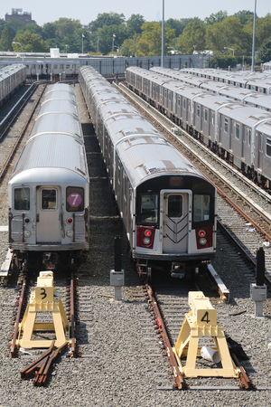 FLUSHING, NEW YORK - SEPTEMBER 5, 2017: NYC subway cars in a depot. It is the most extensive public transportation system in the world by number of stations, with 468 stations in operation Redakční