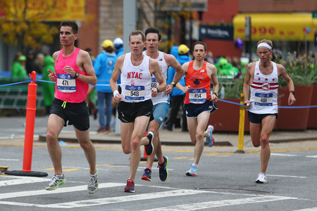 NEW YORK - NOVEMBER 5, 2017: New York City Marathon runners traverse 26.2 miles through all five NYC boroughs to the finish line in Central Park, Manhattan