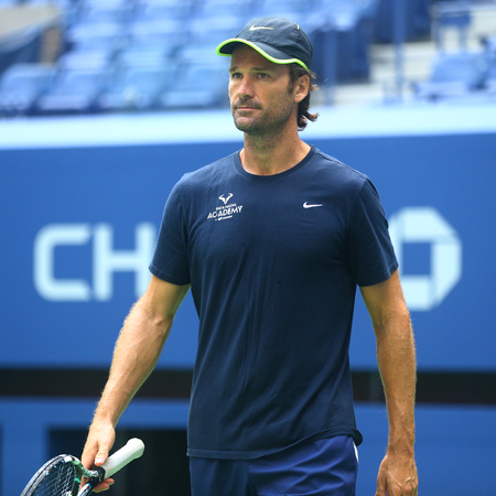 NEW YORK - AUGUST 22, 2017: Rafael Nadals coach Carlos Moya during practice for US Open 2017 at Billie Jean King National Tennis Center in New York