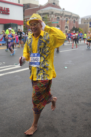 NEW YORK - NOVEMBER 5, 2017: Barefoot New York City Marathon runner traverse 26.2 miles through all five NYC boroughs to the finish line in Central Park, Manhattan