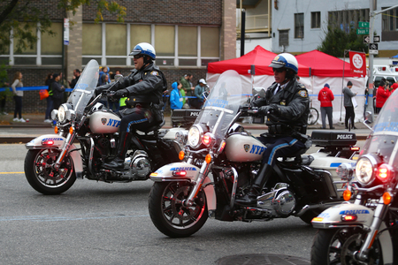 NEW YORK - NOVEMBER 5, 2017: NYPD officers on motorcycles providing security during New York City marathon. New York Police Department, established in 1845, is the largest police force in USA Éditoriale