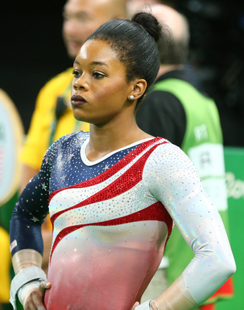 RIO DE JANEIRO, BRAZIL - AUGUST 9, 2016: Olympic champion Gabby Douglas of United States competing at team womens all-around gymnastics at Rio 2016 Olympic Games at Rio Olympic Arena Editorial