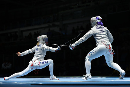 RIO DE JANEIRO, BRAZIL - AUGUST 13, 2016: Dagmara Wozniak of United States (R) and Ekaterina Dyachenko of Russia compete in the Womens Sabre Team of the Rio 2016 Olympic Games at Carioca Arena 3