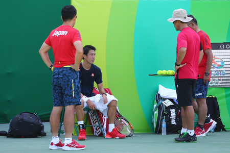 RIO DE JANEIRO, BRAZIL - AUGUST 5, 2016: Professional tennis player Kei Nishikori of Japan during practice for the Rio 2016 Olympic Games at the Olympic Tennis Centre 新聞圖片