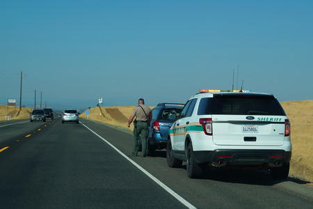 NAPA, CALIFORNIA - SEPTEMBER 16, 2017: Napa County Sheriff Department officer makes traffic stop near Napa City, California Editorial