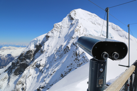 Tourist binocular in Swiss alps Stock Photo