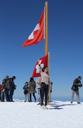 JUNGFRAUJOCH, SWITZERLAND - MAY 5, 2017: Tourists taken pictures from the Plateau observation station on top of the mountain Jungfraujoch, Top of Europe. Editorial